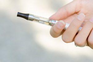 Holding a starter v2 e-cigarette starter kit