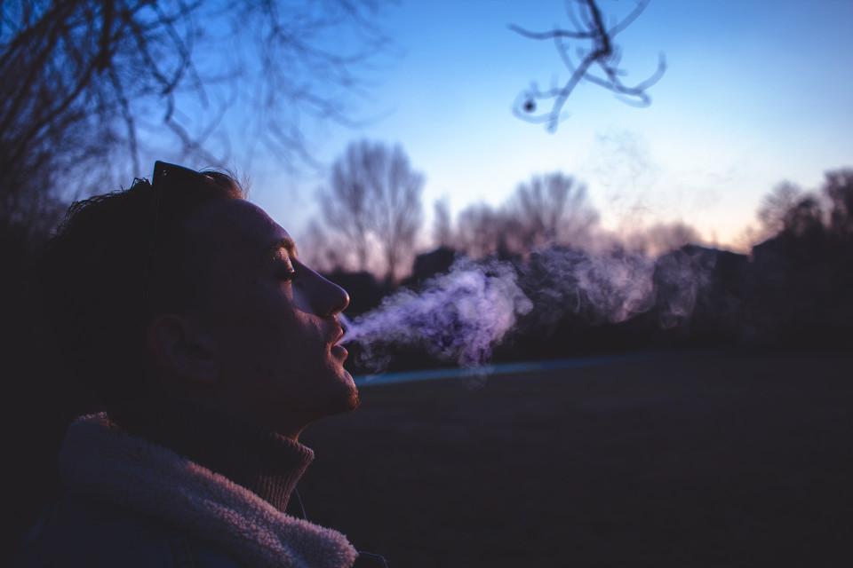 Man Puffing E-Cigarette Clouds