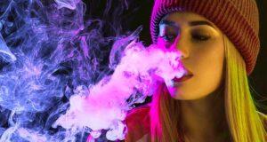Woman Vaping Menthol Vape Essentials